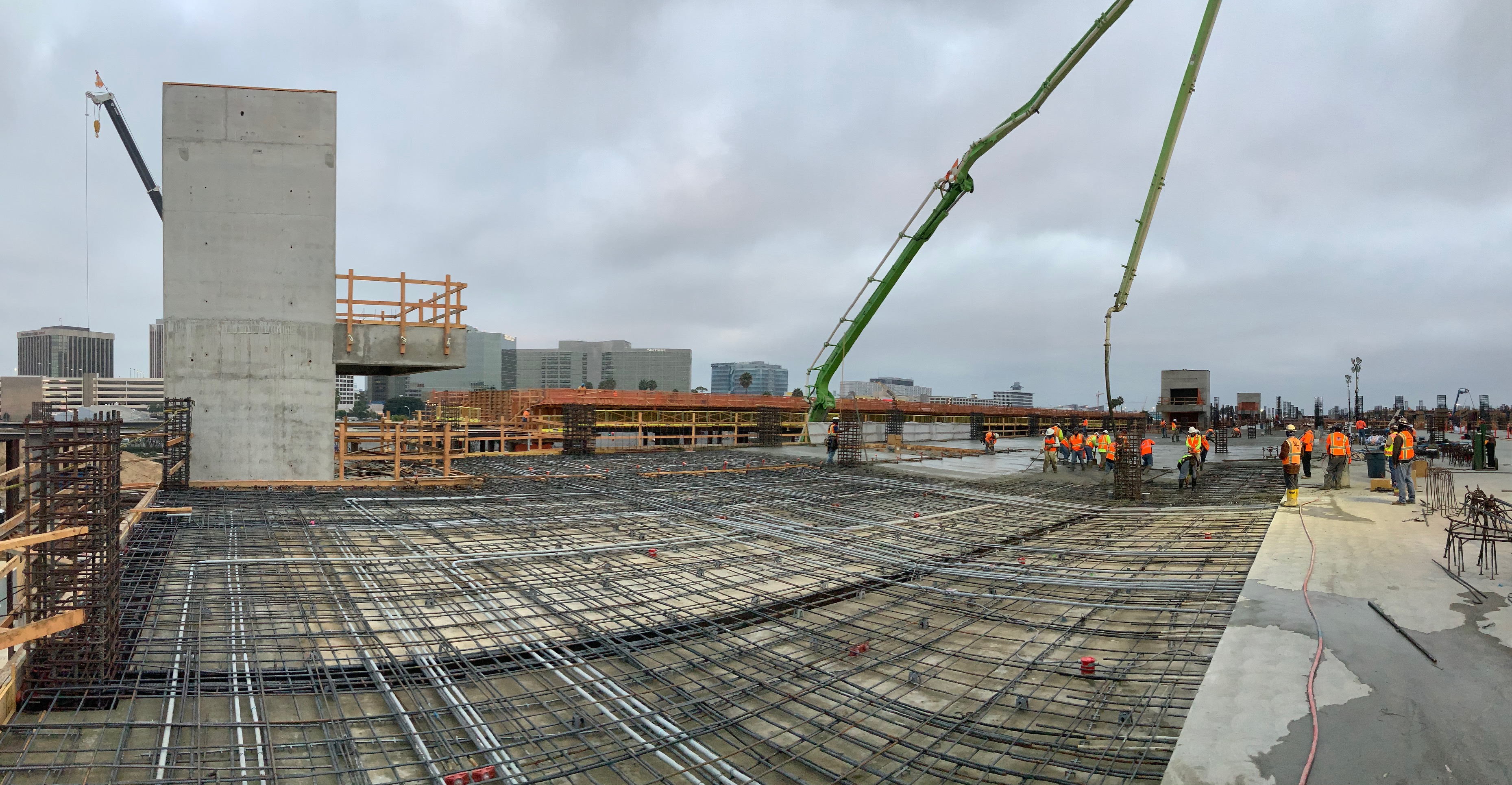 Workers pour the final concrete for the third level deck of the Intermodal Transportation Facility-West.