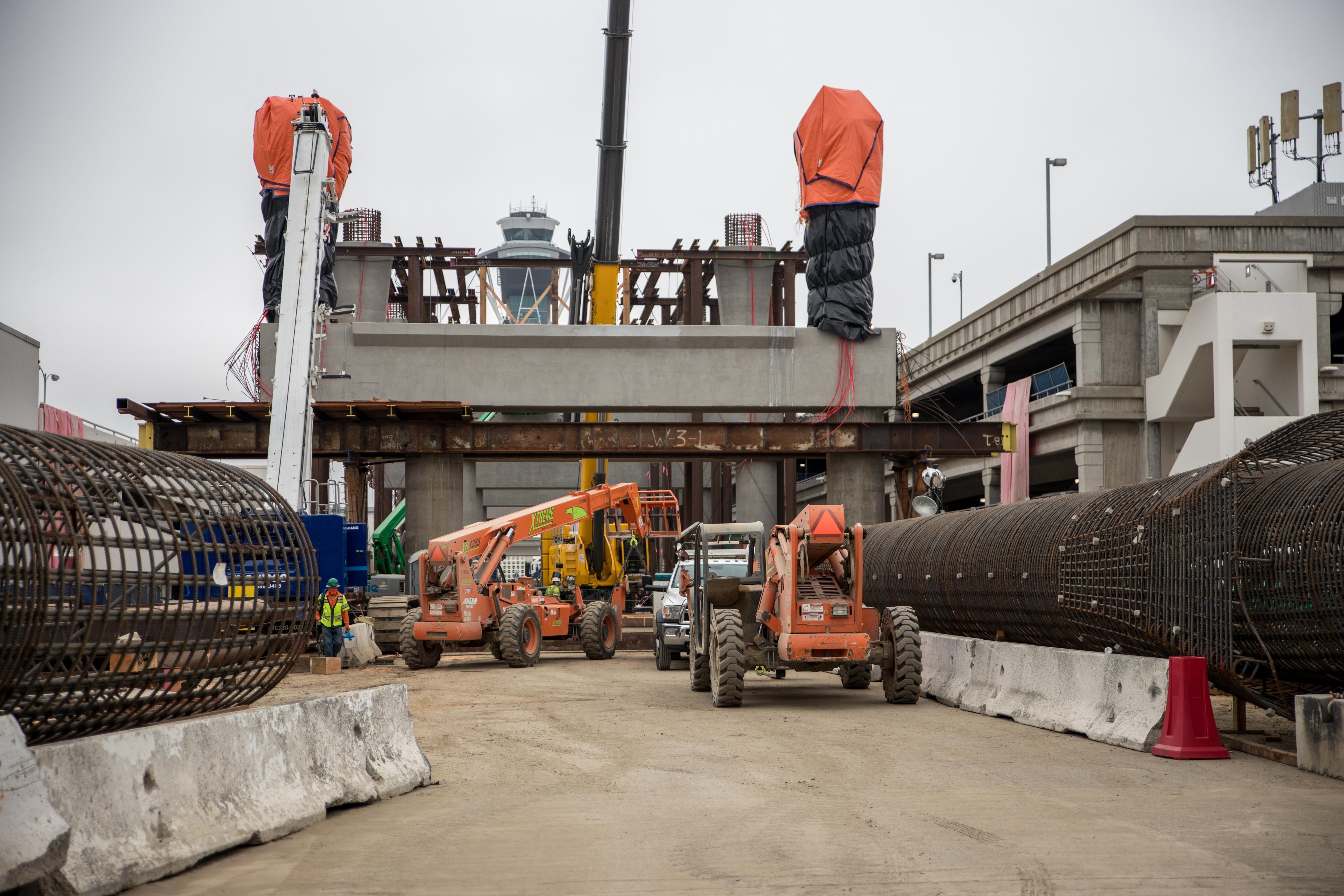 Concrete for the final two upper columns at the future East CTA station cures.