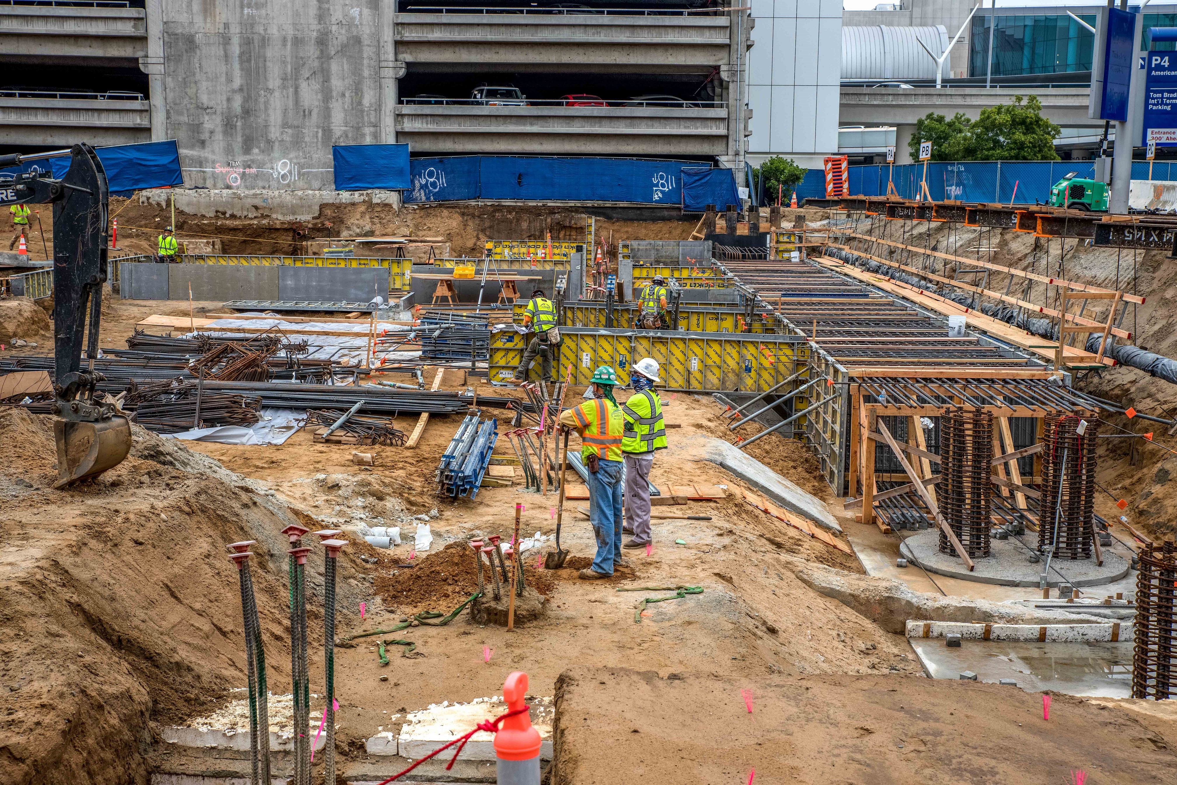 Crews install pile caps, prefabricated metal forms and place grade beam steel at the future West CTA station.