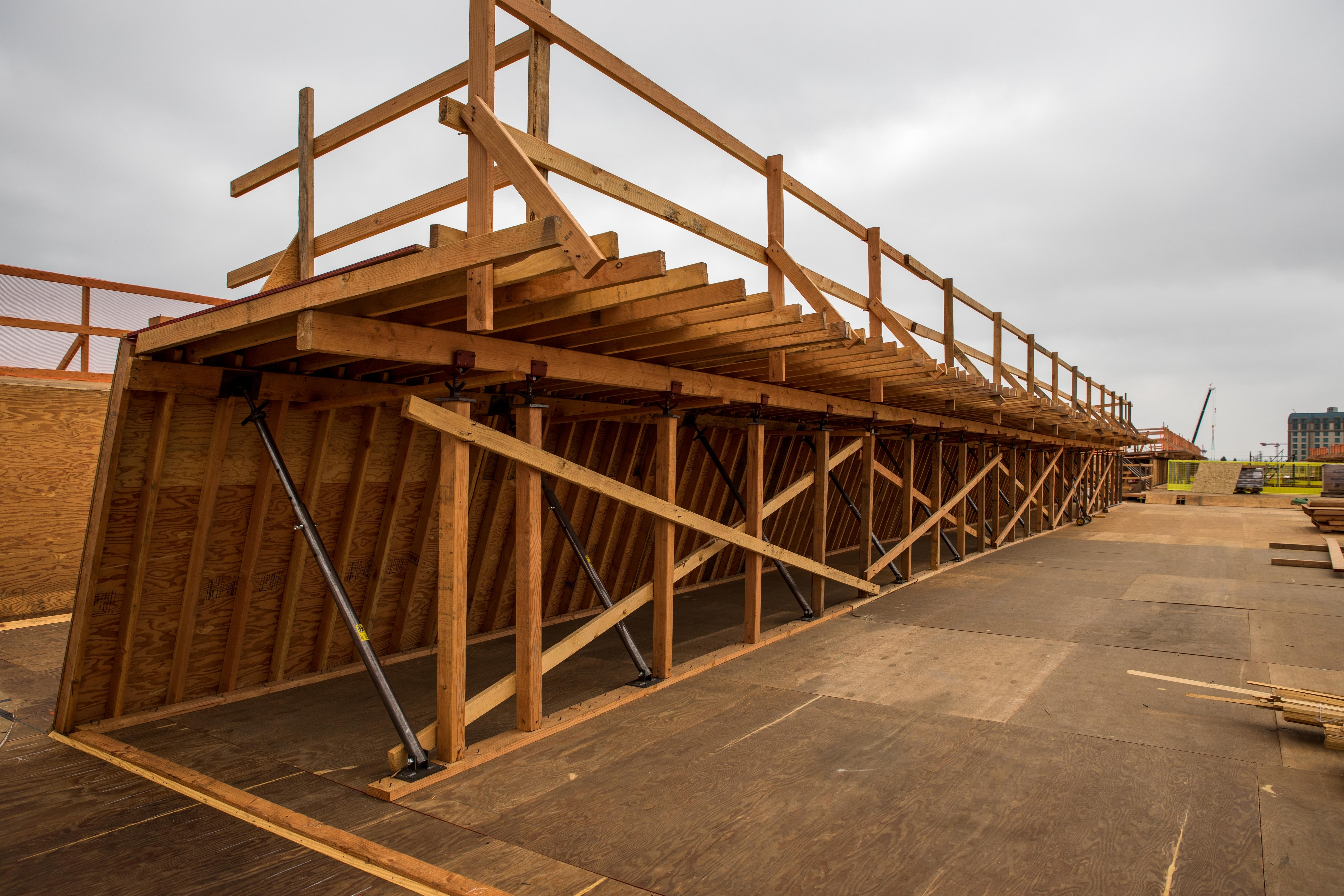 Utilizing a cast-in-place technique, guideway formwork is constructed in preparation for concrete placement.