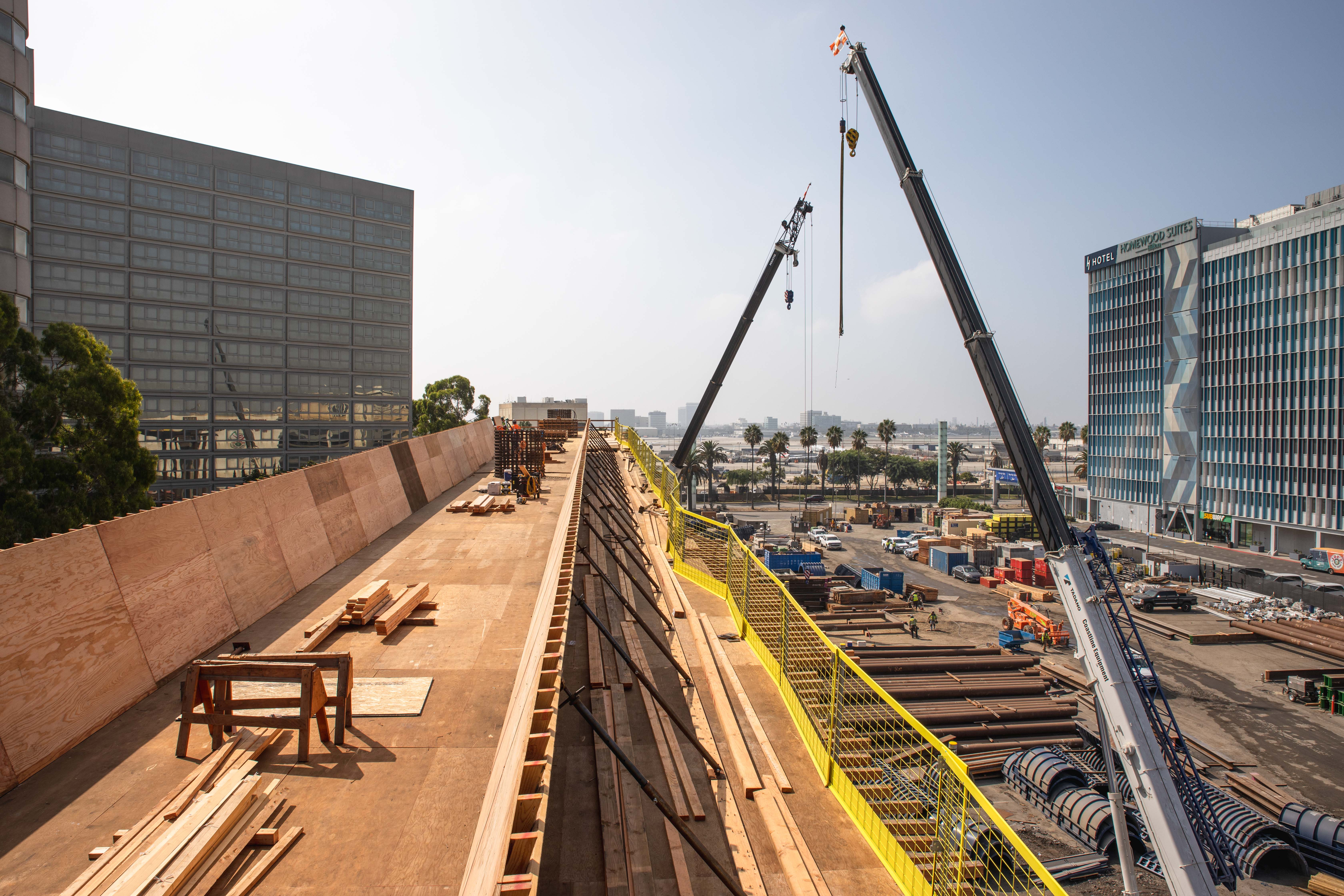 Preparations for concrete placement continue as the APM guideway approaches Century Boulevard.