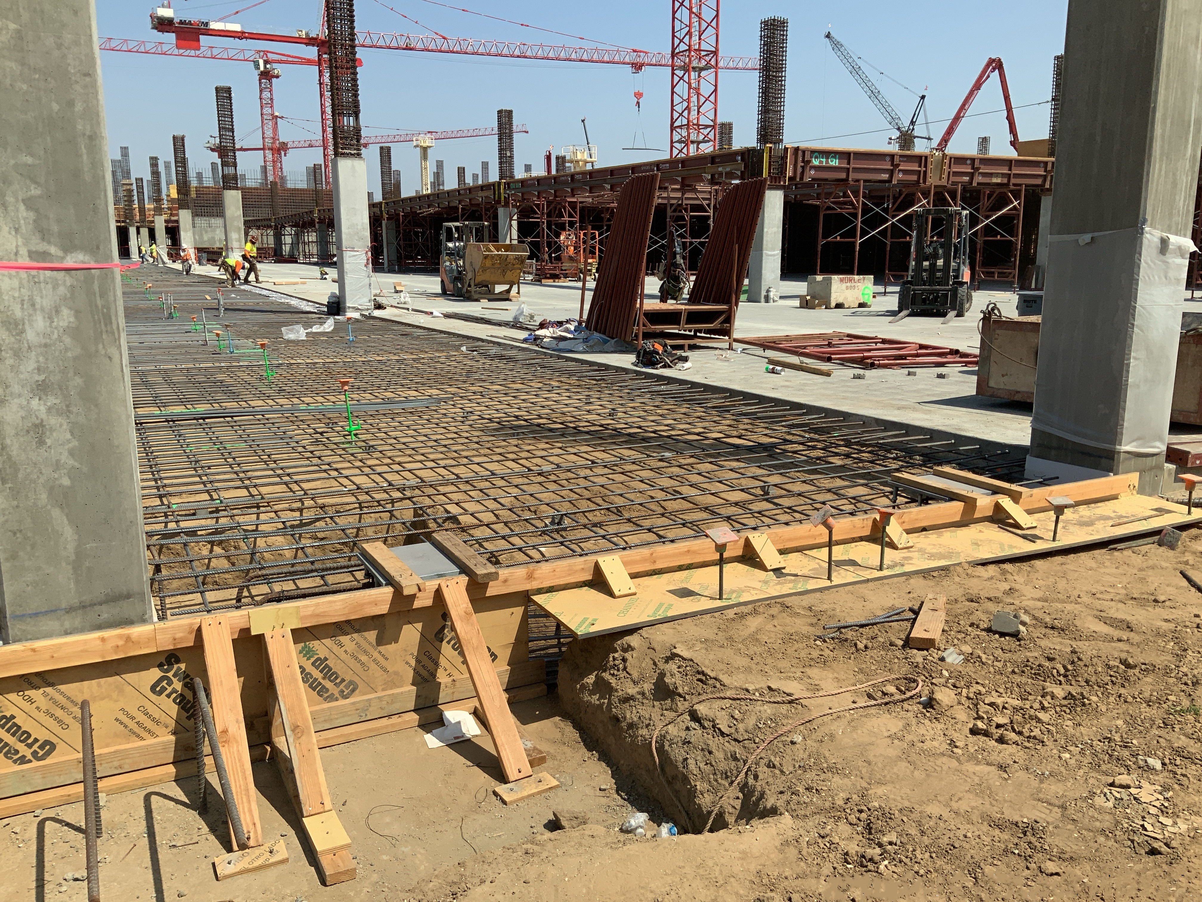 Intallation of rebar and embeds in preparation for slab pour at the Consolidated Rent-A-Car facility Ready Return/Idle Storage building.