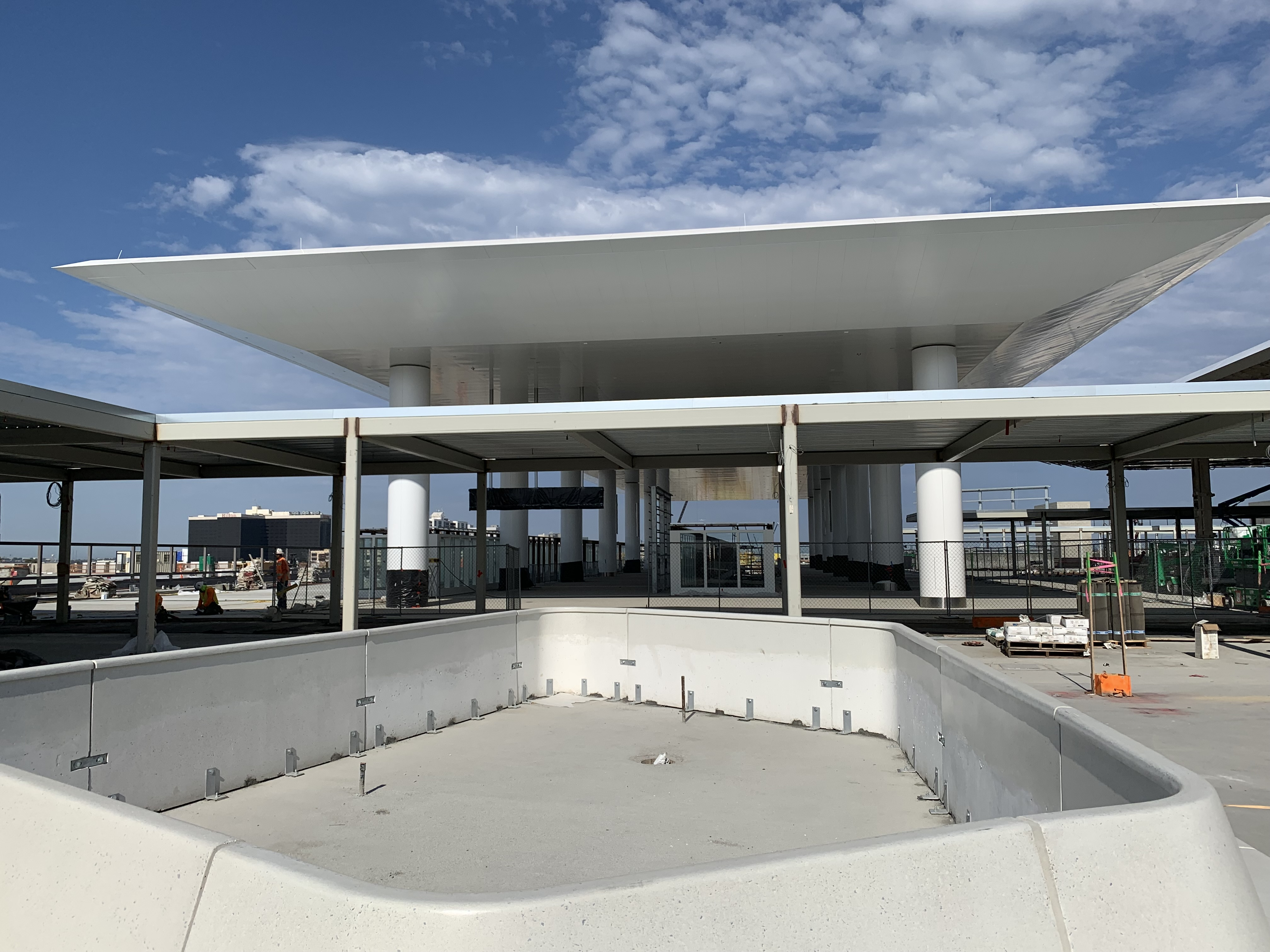 A precast planter bench, in front of the Automated People Mover station, on the top level of the Consolidated Rent-A-Car facility's Ready Return building.